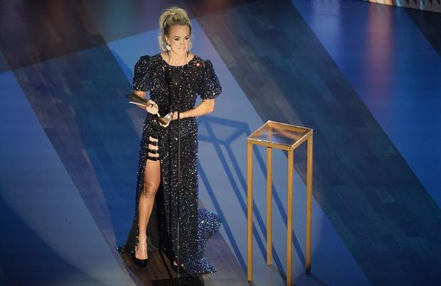 Carrie Underwood accepts the entertainer of the year award during the 55th annual Academy of Country Music Awards at the Grand Ole Opry House on Wednesday, Sept. 16, 2020, in Nashville, Tenn. [AP Photo/Mark Humphrey]