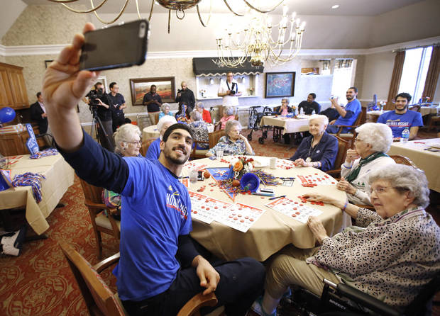 Oklahoma City Thunder's Enes Kanter takes a selfie at Brookdale Village, a senior living community in Oklahoma City, Monday November, 29 2016. Thunder players Alex Abrines, Steven Adams, Enes Kanter and Andre Roberson played bingo with residents. Photo By Steve Gooch, The Oklahoman