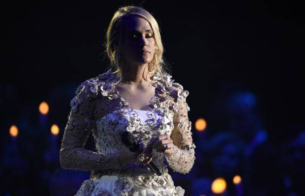 Photos from angelic white to royal blue carrie underwood for Carrie underwood softly and tenderly