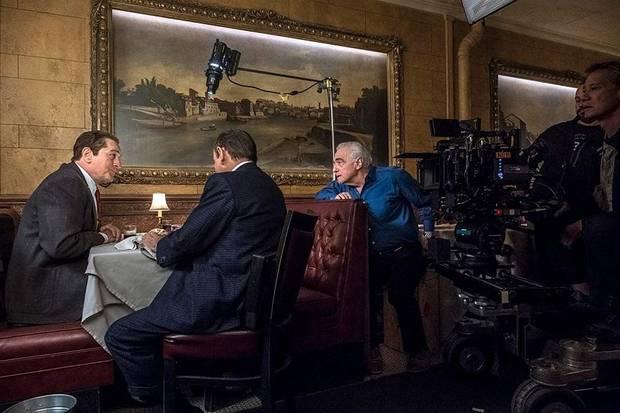 "From left, Robert De Niro, Joe Pesci and Martin Scorsese work behind the scenes on ""The Irishman."" [Netflix photo]"