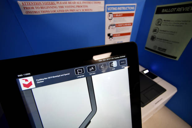 Georgia county punished for ditching voting machines