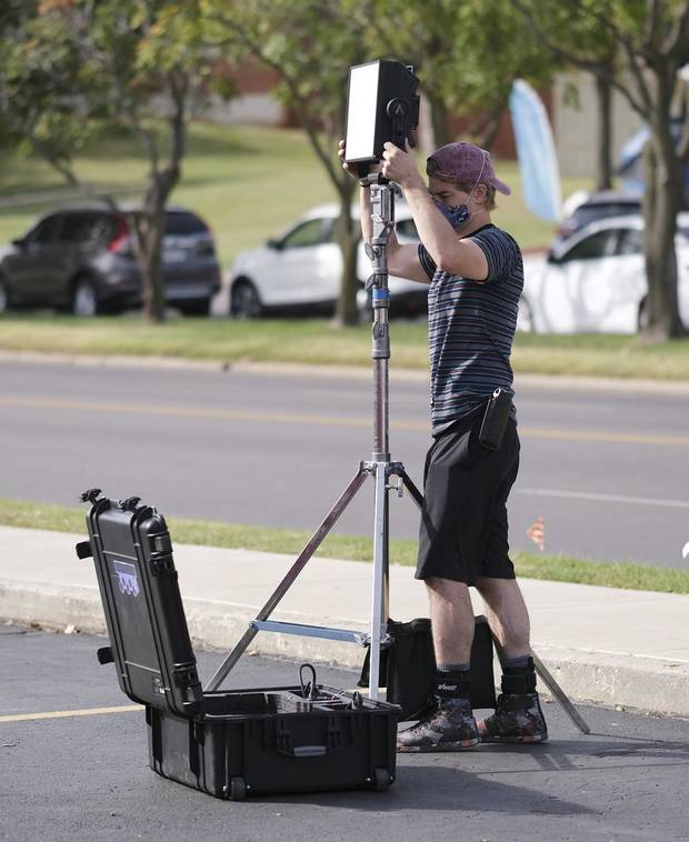 "A crew member works on the set of the Oklahoma film ""Out of Exile"" at the Flamingo Apartments on NW 23 St. Thursday, October 15, 2020. [Doug Hoke/The Oklahoman]"