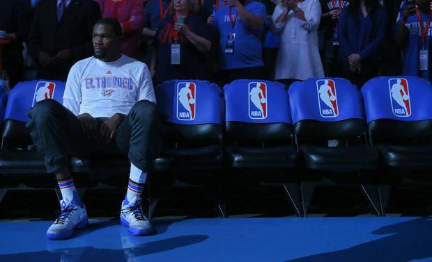 Oklahoma City's Kevin Durant (35) sits on the bench as they do player introductions during the NBA basketball game between the Oklahoma City Thunder and the Los Angeles Clippers at Chesapeake Energy Arena on Wednesday, March 9, 2016, in Oklahoma City, Okla. Photo by Chris Landsberger, The Oklahoman