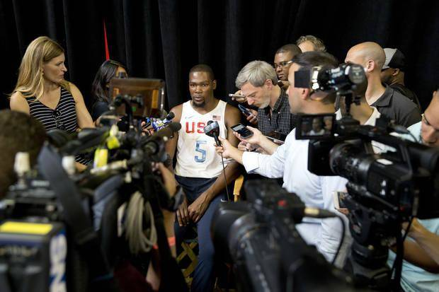 Oklahoma City star Kevin Durant, shown here in his Team USA uniform, is interviewed by reporters. Many questions surround his free agency and who he will sign with this summer. (AP Photo)