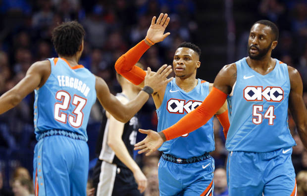 Oklahoma City's Terrance Ferguson (23), Russell Westbrook (0) and Patrick Patterson (54) celebrate as a San Antonio timeout is called after a three-point shot by Ferguson during an NBA basketball game between the San Antonio Spurs and the Oklahoma City Thunder at Chesapeake Energy Arena in Oklahoma City, Saturday, Jan. 12, 2019. Photo by Nate Billings, The Oklahoman