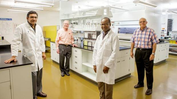 OSU President Burns Hargis (second from left) poses with diagnostic lab leaders (from left) Akhilesh Ramachandran, Jerry Saliki and Dean Carlos Risco. [PHOTO PROVIDED]