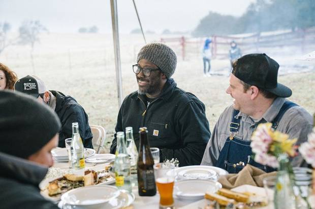 "W. Kamau Bell, center, appears in Sunday's episode of ""United Shades of America,"" which will focus on Oklahoma's independent farmers. [CNN photo]"