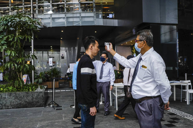The Latest: Singapore quarantines almost 20K foreign workers