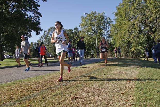 Members of the women's cross country team run on campus at the University of Science and Arts of Oklahoma. [Photo provided by USAO]