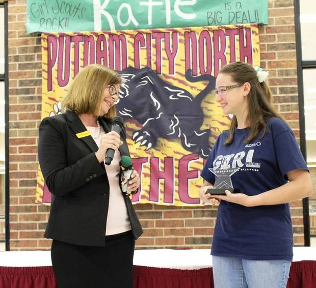 Oklahoma Girl Scout Katie Francis, right, who this spring broke the record for the most cookies sold over the course of a Girl Scout career, recently got to meet with Elizabeth Brinton, the previous record holder, at a special assembly at Katie's high school, Putnam City North. Photo provided