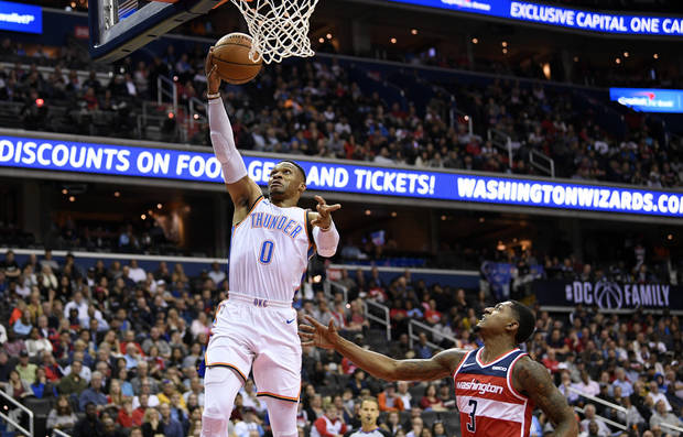 3088a2d23 Oklahoma City Thunder guard Russell Westbrook (0) goes to the basket next  to Washington