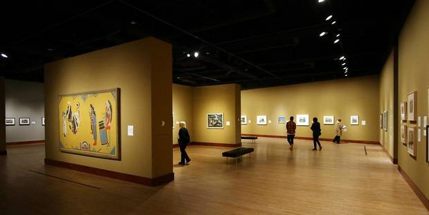 "Visitors look at artworks in the Oklahoma City Museum of Art exhibit ""Renewing the American Spirit: the Art of the Great Depression"" Wednesday, October 30, 2019. [Doug Hoke/The Oklahoman]"