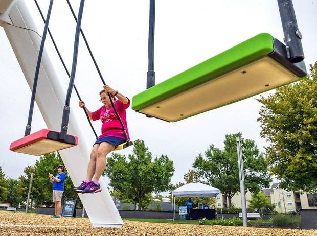 Annette Hamm takes a ride on The Musical Swings set up at Bicentennial Park in Oklahoma City, Okla. on Monday, Sept. 23, 2019. The swings are set up as part of the Oklahoma City Community Foundation's 50th anniversary. [Chris Landsberger/The Oklahoman]