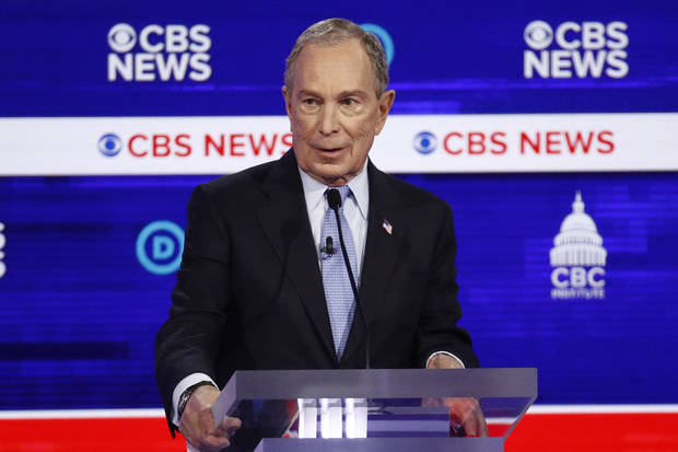 The Latest: Bloomberg nearly says he 'bought' House freshmen
