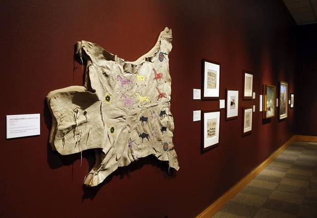 """Pictorial Robe"" by an unknown artist, circa 1890, is on display in ""Ancient. Massive. Wild – The Bison Exhibit"" at the National Cowboy & Western Heritage Museum in Oklahoma City, Thursday, Feb. 7, 2019. [Photo by Nate Billings/The Oklahoman]"