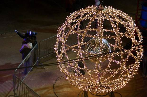 People take selfies in front of the giant lighted ball at Opening Night 2019 in Bicentennial Park in downtown Oklahoma City, Monday, December 31, 2018. [Doug Hoke/The Oklahoman Archives]