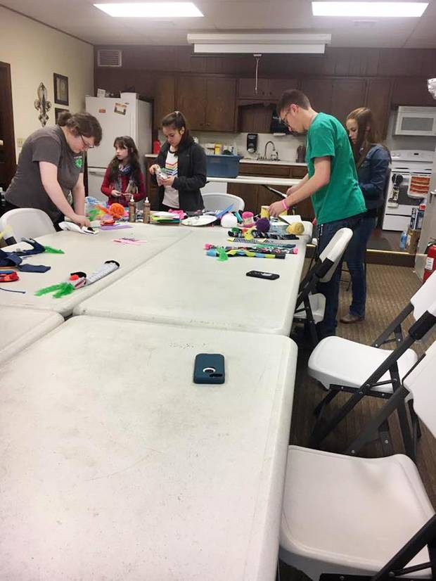 Cleveland County 4-H members host a workshop in Norman to make crazy sock puppets for World Down Syndrome Day. [PHOTO PROVIDED]