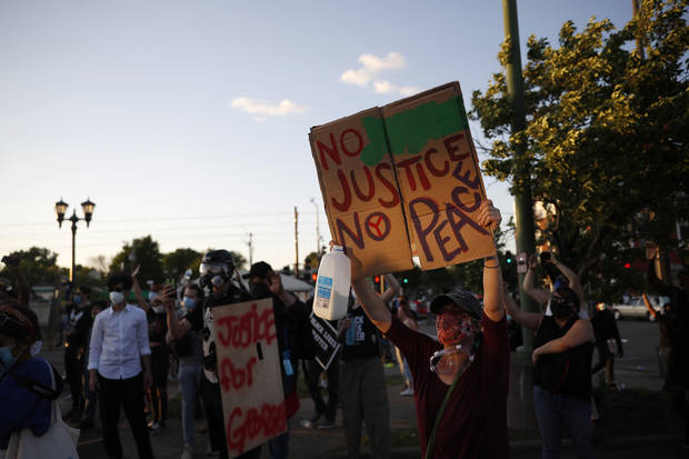 Protesters enter Minneapolis police station, set fires