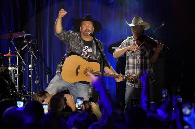 Garth Brooks performs at Joe's in Chicago, Monday, July 15, 2019, on the first stop of his Dive Bar tour. Garth has partnered with Seagram's 7 Crown to secure 700,000 pledges to #JoinThePact, a pledge to never drive impaired. (Photo by Rob Grabowski/Invision/AP)