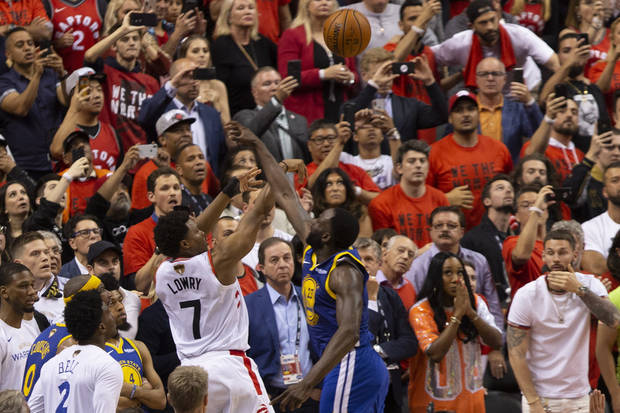 Draymond Green blocks Kyle Lowry's last-second 3-point shot in Game 5. (The Canadian Press via AP)