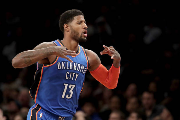 Oklahoma City Thunder forward Paul George gestures after scoring a basket  against the Brooklyn Nets during 282e4c8a4