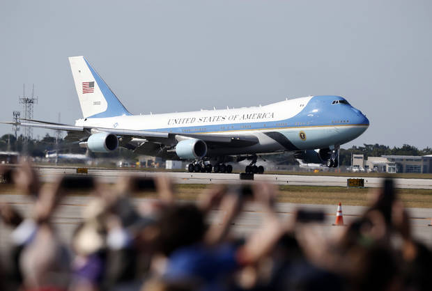 Spectators use their cell phones to photograph Air Force One as it lands with President Donald Trump aboard in West Palm Beach, Fla., Friday, Feb. 17, 2017. (AP Photo/Wilfredo Lee)