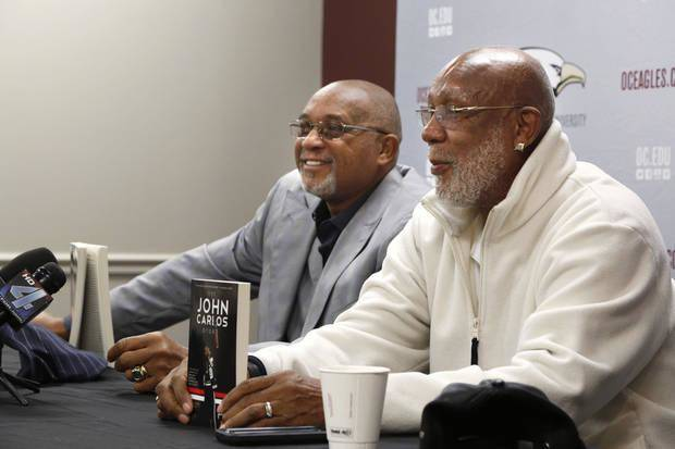 Tommie Smith (left) and John Carlos chat at Oklahoma Christian University. (Photo by Paul Hellstern)