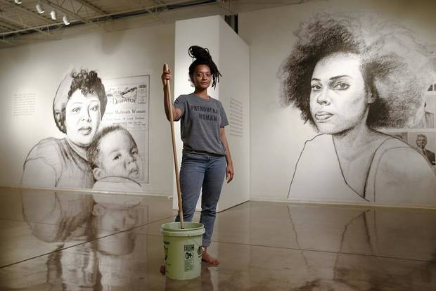 "Artist Tatyana Fazlalizadeh poses for a portrait as she installs her artwork for her exhibit, ""Oklahoma Is Black,"" a depiction and celebration of Oklahoma City's rich black history at Oklahoma Contemporary in Oklahoma City, Tuesday, Feb. 19, 2019. [Photo by Bryan Terry/The Oklahoman Archives]"