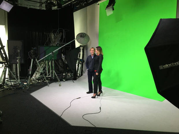 Bart Conner and Nadia Comaneci shooting a commercial in The Oklahoman's video studio on Monday.