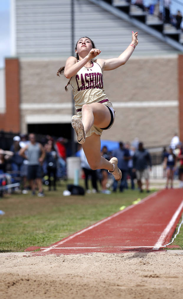 Cashion's Madelyn McCabe jumps in the long jump during the Class A and 2A state track and field championship at Western Heights High School in Oklahoma City, Saturday, May 4, 2019. Photo by Sarah Phipps, The Oklahoman