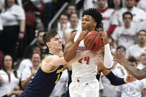 COLLEGE BASKETBALL NOTEBOOK: Top-ranked Louisville overpowers No. 4 Michigan