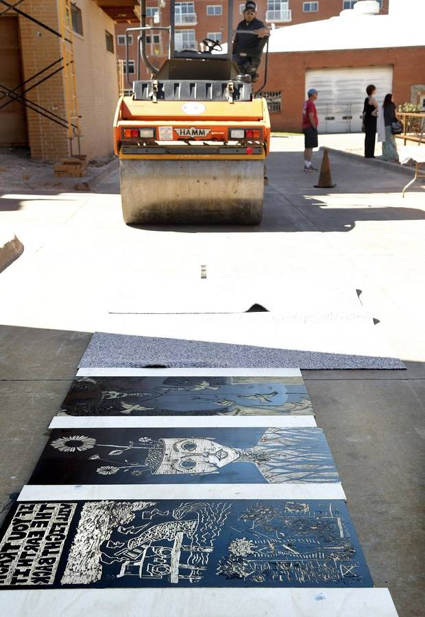 Artspace at Untitled's 2017 Steamroller Festival featured the printing of large-scale blocks that are carved from wood and printed on Tyvek with a 5-ton steamroller. Artspace at Untitled is an art gallery and print studio located in the Deep Deuce District, just east of Broadway. [Photo by Jim Beckel/The Oklahoman Archives]