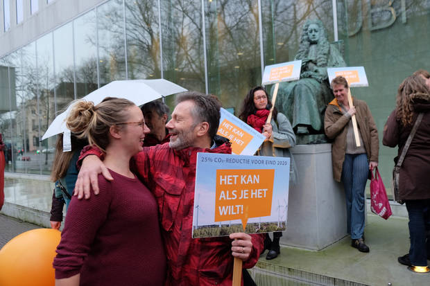 Activists cheer victory in landmark Dutch climate case