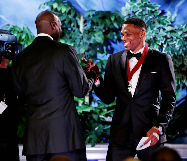 Michael Jordan introduces and shakes hands with Thunder guard Russell Westbrook as Westbrook is inducted into the Oklahoma Hall of Fame during the Oklahoma Hall of Fame Banquet and Induction Ceremony on Thursday, Nov. 17, 2016 in Oklahoma City. (Photo courtesy Oklahoma Hall of Fame)