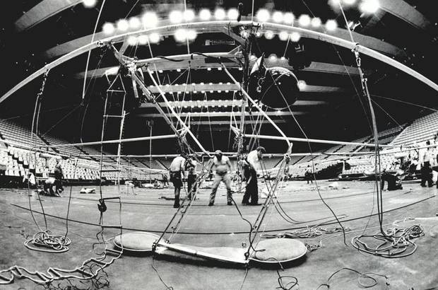 June 23, 1983: Workers prepare overhead rigging for one of three rings to be featured in the Ringling Bros. and Barnum & Bailey Circus. [Photo by Roger Klock, The Oklahoman Archives]