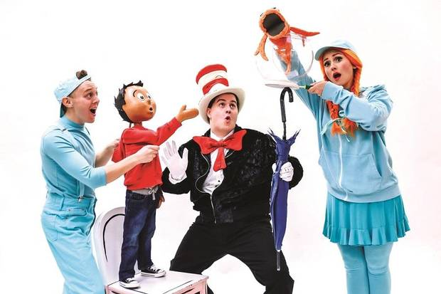 "From left, Eli Bradley plays The Boy, Josiah Brooks stars as the title character, and Lexi Windsor plays the Fish in Lyric Theatre's production of Dr. Seuss' ""The Cat in the Hat."" [K. Talley Photography]"