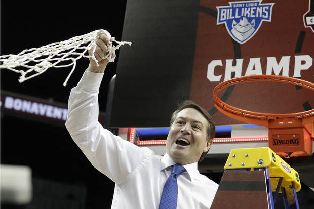 Saint Louis coach Travis Ford waves the net after winning Atlantic-10 Tournament Sunday. (AP Photo)