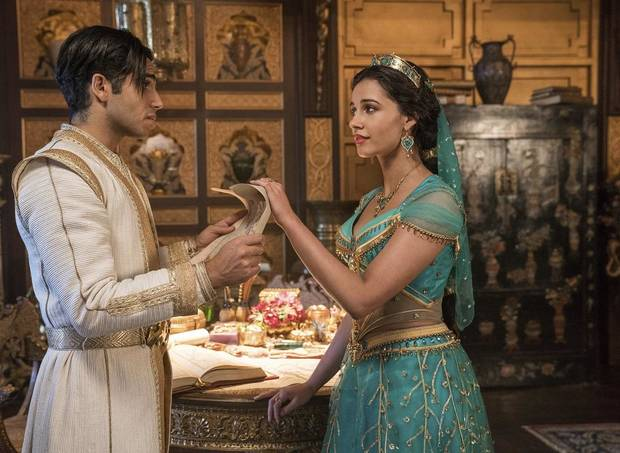 "Mena Massoud stars as Aladdin, left, and Naomi Scott as Jasmine in Disney's live-action adaptation of the 1992 animated classic ""Aladdin."" [Disney photo]"