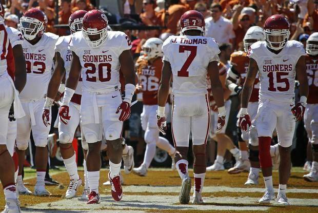 Sooners Jordan Wade (93), Frank Shannon (20), Jordan Thomas (7) and Zack Sanchez (15) trudge back to the sideline after a Texas touchdown on Oct. 10. (Photo by Bryan Terry) , The Oklahoman | Imported: Sat. Oct 10, 2015