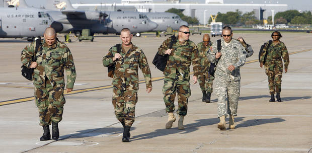 ILLEGAL IMMIGRATION, IMMIGRANTS: Oklahoma Army National Guard members of the 120th Combat Engineers unit walk onto the flight line at a Guard hanger at Will Rogers World Airport in Oklahoma City Thursday Sept. 7, 2006, to board a national guard plane bound for Las Cruces, New Mexico, to participate in Operation Jump Start to better secure the nation's border with Mexico. 13 engineers from the unit flew out Thursday to participate in the operation. BY PAUL B. SOUTHERLAND, THE OKLAHOMAN ORG XMIT: KOD