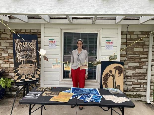 Alexa Goetzinger shows off a mock setup for this weekend's Oklahoma Art Crawl. [Photo provided]
