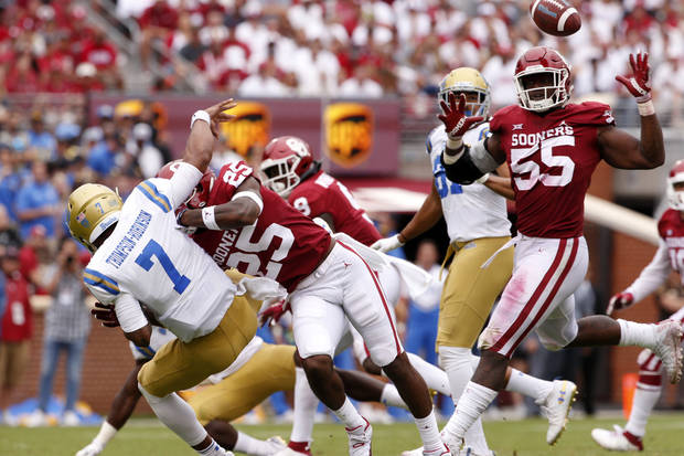 OU's Justin Broiles (25) breaks up a pass by UCLA's Dorian Thompson-Robinson (7) in the Sooners' 49-21 victory last September on Owen Field. (Oklahoman photo)