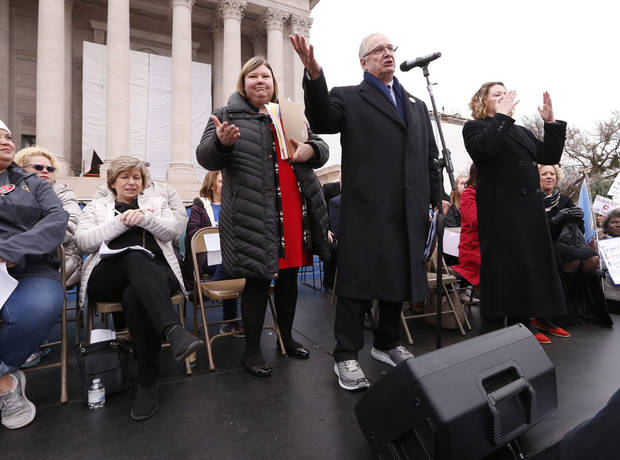 Oklahoma Education Association President Alicia Priest, and Ed Allen stand on the stage as Oklahoma teachers hold a rally at the State Capitol on Monday, April 2, 2018 in Oklahoma City, Okla. Photo by Steve Sisney, The Oklahoman