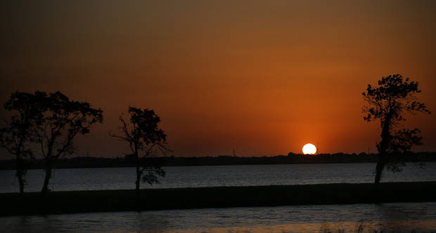 The sun sets on July 21, 2017 at Lake Overholser in Oklahoma City. [Photo by Sarah Phipps, The Oklahoman]