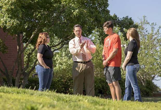 OSU Institute of Technology President Bill Path talks with students on the Okmulgee campus in spring 2017. [Photo Provided by OSUIT Marketing & Communications Services]