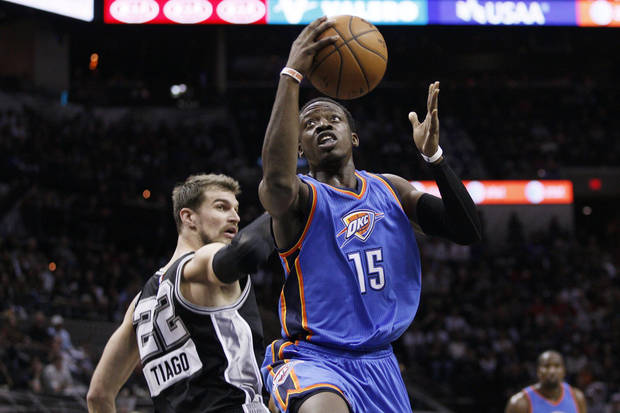 Dec 25, 2014; San Antonio, TX, USA; Oklahoma City Thunder point guard Reggie Jackson (15) drives to the basket past San Antonio Spurs power forward Tiago Splitter (22) during the second half at AT&T Center. Mandatory Credit: Soobum Im-USA TODAY Sports