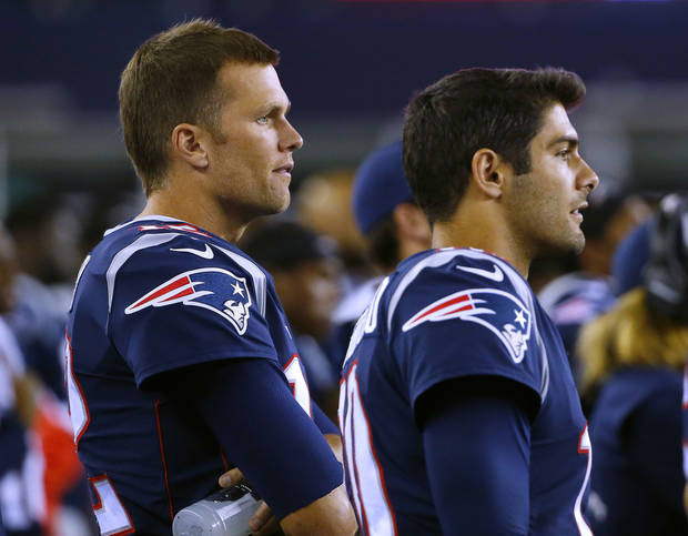 Tom Brady (left) and Jimmy Garoppolo stand on the sideline during a New England exhibition game in August. (AP Photo)