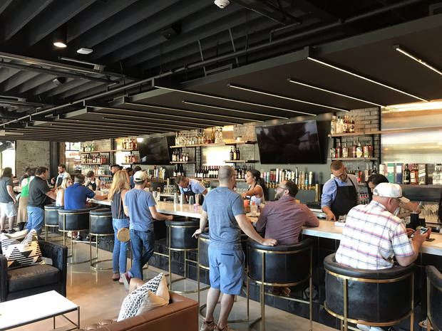 The bar fills up inside The Collective, a new food hall in downtown Oklahoma City. [Dave Cathey/The Oklahoman]