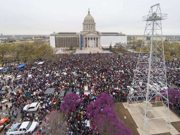 A large crowd of teachers, students and supporters gather on the south side of the Capitol Monday, April 2, 2018. Photo by Todd Fraser, The Oklahoman