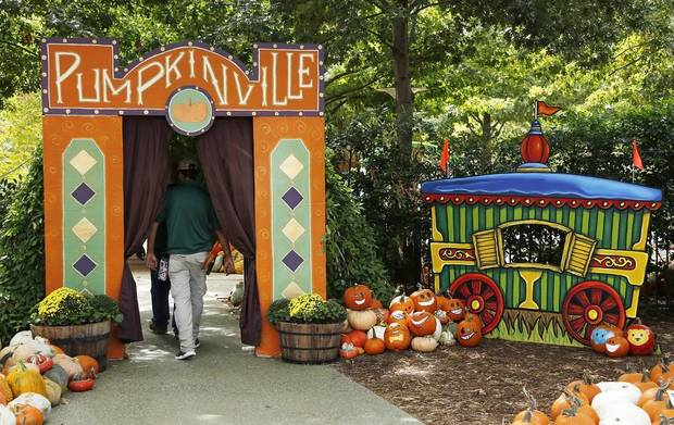 In keeping with this year's vintage carnival theme, local artist Nick Bayer created an old-fashioned train car for the entrance to Pumpkinville, which opens Friday. Setup for Pumpkinville in the Children's Garden at the Myriad Botanical Gardens continues Wednesday, October 9, 2019. [Doug Hoke/The Oklahoman]